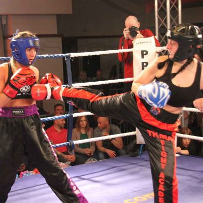 Amy Oglesbee fires a Back Kick to Rachael Mccarran at the International kickboxing event at the stormont Hotel