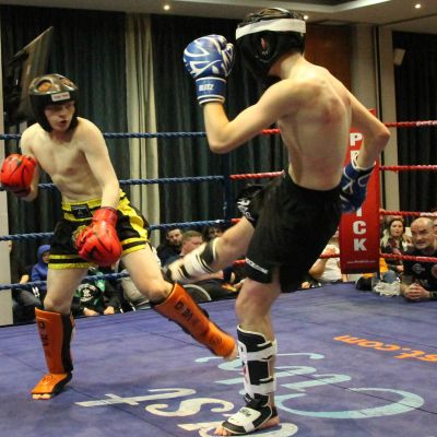 Joshua Madden (Belfast, NI) lands a low-kick to Liam Green (WestBank Kickboxing Club, Derry)