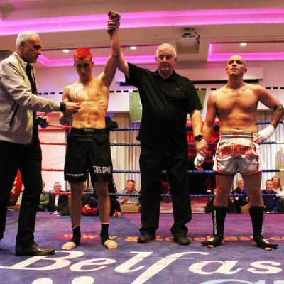 Killian Emery pictured gets the official nod from the WKN president and Shane Weir and referee Mr Bob Hunter after their kickboxing match at the Stormont hotel Saturday 23rd FEB 2019