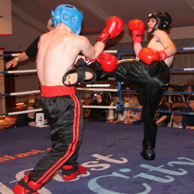 Jack Molloy takes a round kick from Micheal McKay at the Stormont hotel in Belfast at Billy Murray's ProKick event.