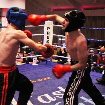Jack Molloy takes a right hook punch from Micheal McKay at the Stormont hotel in Belfast at Billy Murray's ProKick event.