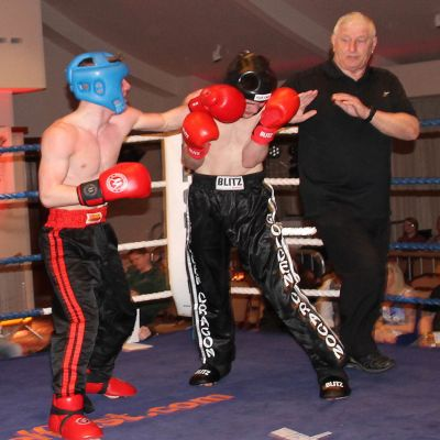 Jack Molloy lands a punch on Micheal McKay at the Stormont hotel in Belfast at Billy Murray's ProKick event.