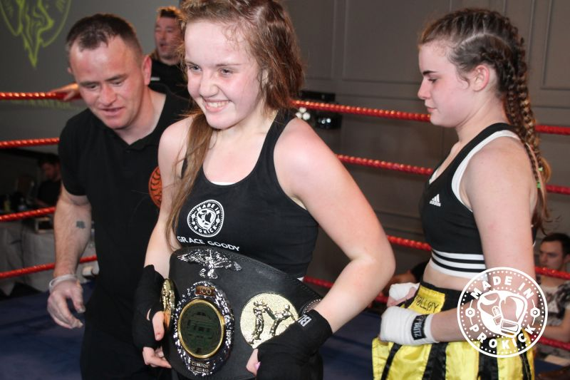 New Champ Amazing Grace Goody with good sport Jade Molloy placing the belt on Grace.