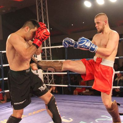 Patron hits home with a good front kick to Salman at the International kickboxing event in Belfast