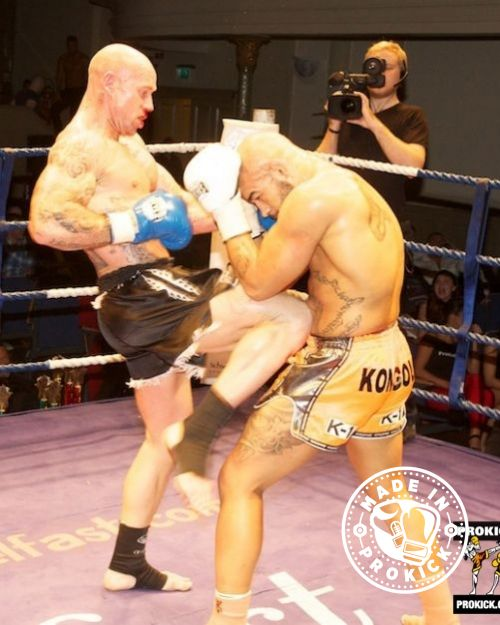 Action as Yohan Kongolo takes a knee from Aidan Brooks at KickMASS 2013 at the Ulster Hall in Belfast