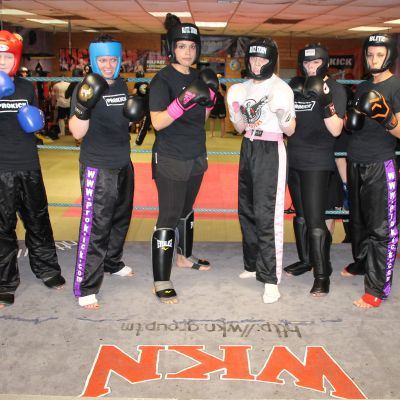 Ladies and a man mix it up in sparring