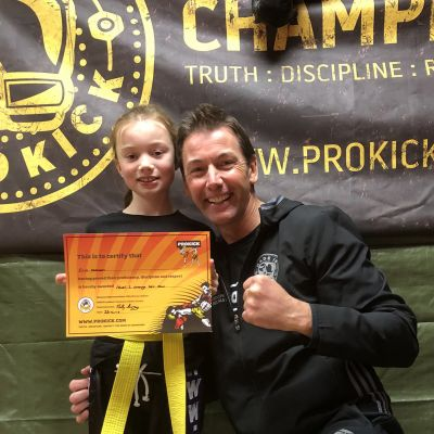 Daddy's Girl hit Gold - Erin Dobson is all smiles after obtaining her orange belt but the biggest smile belongs to her Dad  senior ProKick brown belt Mr Paul Dobson 'A Proud Dad'