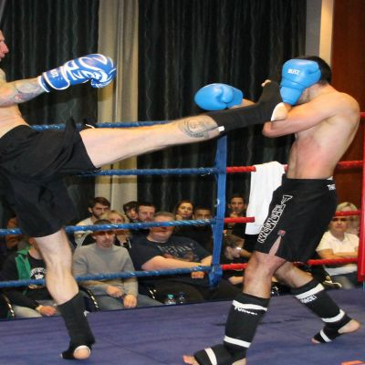 Darren McMullan throws a high kick to Nikos Kollias (Cyprus)