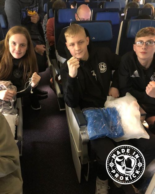 Prokick teens on the plane to Japan.