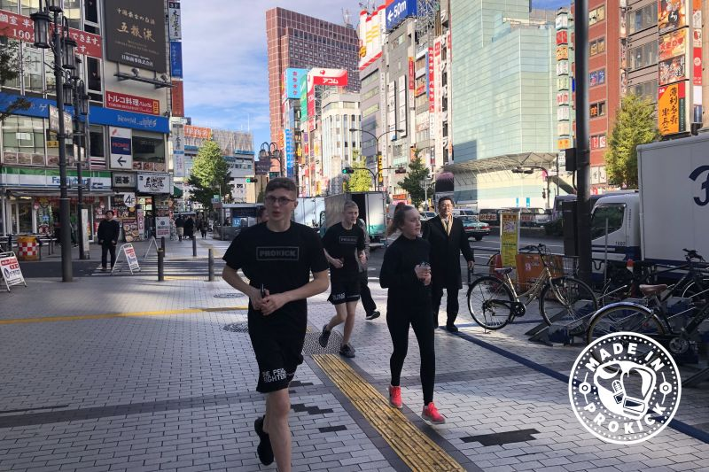 Running through the streets of downtown Tokyo