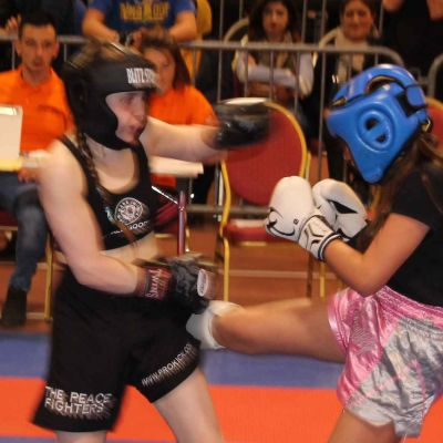 Swiss fighters lands kick to Grace Goody at the WMAG in Switzerland