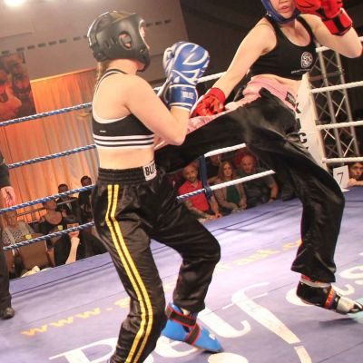 Grace Jump Round Kick lands to Jade Molloy at the Stormont Hotel on Saturday 17th FEB 2018