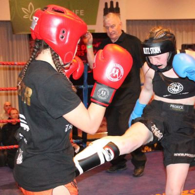 Grace lands a Low-kick to Cypriot Papadopoulouat the Stormont hotel in Belfast on the 23rd FEB 2019.