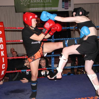 Grace takes a front kick from Cyprus' Papadopoulou