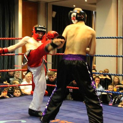 Jack Anderson shoots a good round kick to James Braniff at the Clayton hotel fight day