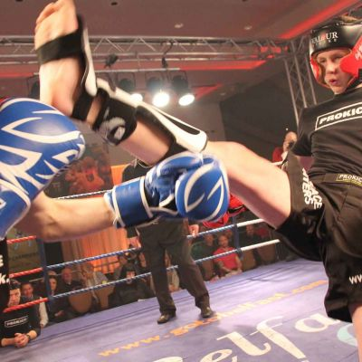 Jay tries a front kick to opponent Filip Nowak (Krakow, Poland) at the Stormont Hotel Belfast.