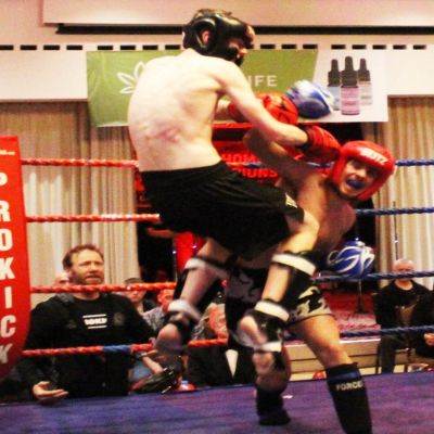 Jay flies high as he tries a jumping Knee strike displaying a range of shots that slowed down his opponent