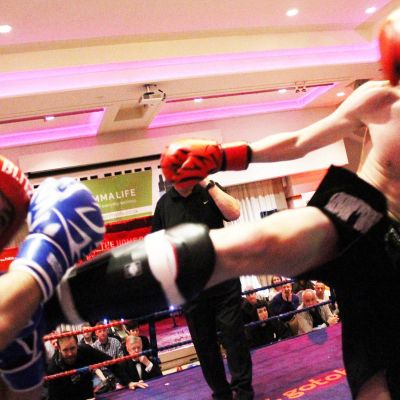 Jay fires a round kick to Charalambous - Two young teenagers showed they belong on the big stage after a non-stop treat in K-1 Style kickboxing matched at 56kg Jay Snodden (Dundonald, NI) faced Nikolas Charalambous of (Cyprus) over 3x2 minute rounds.