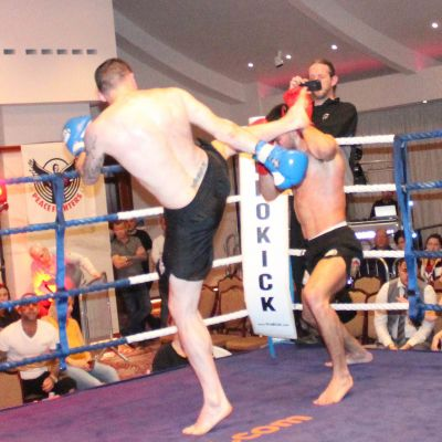 Johnny Swift Smith fires a high kick Christos Venizelou (Cyprus) At the Stormont Hotel Saturday 23rd Feb 2019