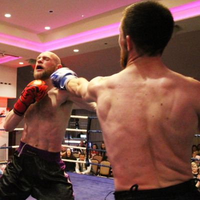 Kerr Takes It On Chin from Thomas Poullain (Switzerland) at the ProKick event at the Stormont hotel on 23rd FEB 2019