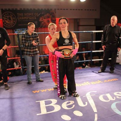Kerry Presents Respect, Kerry Doyle places the Belt around Rowena