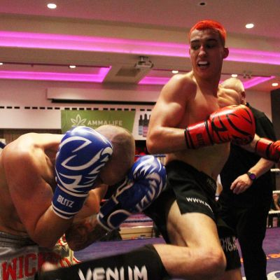 Killian Emery fires a Jumping Back Kick to the body of Shane Weir in Belfast's ProKick event at the Stormont hotel