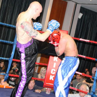 Matthew Kerr lands a round kick the Shane Weir (Fraserburgh)