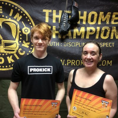 Mrs Lam and Son Matthew train together at the ProKick gym, well done you two on passing your orange belts.