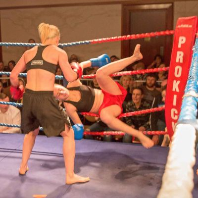 Cathy McAleer Punches Polish champion Ciaskowska through the ropes at the Stormont Hotel