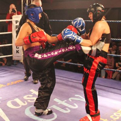 Rachael lands a front Kick to Amy Oglesbee at the Stormont Hotel