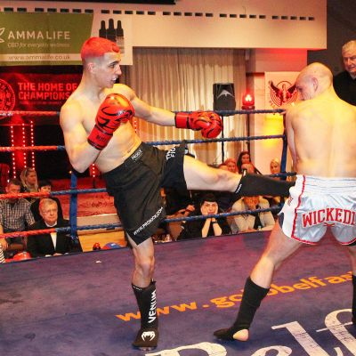 Round Kick as Killian lands a hard kick to the body of Shane Weir in Belfast's ProKick event at the Stormont hotel
