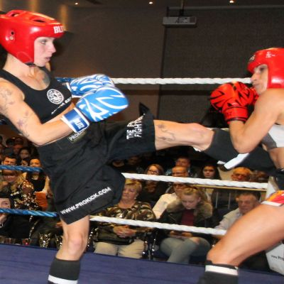 Rowena lands a hard round kick to Valentina at the Clayton Hotel in Belfast