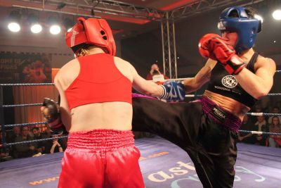 Kerry Doyle  takes a hard road kick doing the WKN irish title fight from rowena Bolt