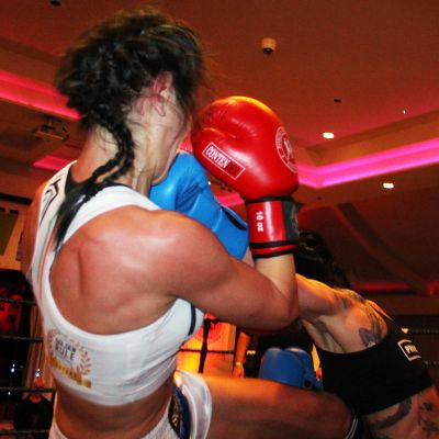 Rowena Bolt in kickboxing action with Italian Maura Scano in their low-kick style match at the Stormont hotel in Belfast
