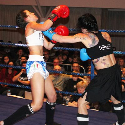 Rowena lands another punch Italian Maura Scano in their low-kick style match at the Stormont hotel in Belfast