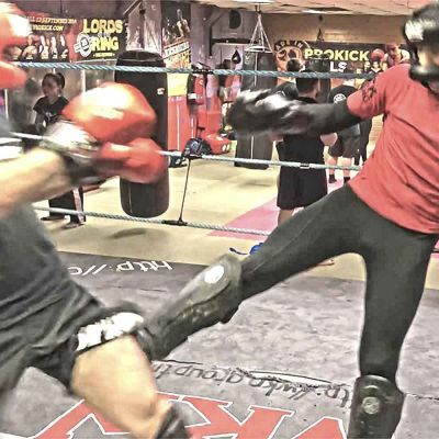 Salman Shariati takes a low-kick from Rafa del Toro during a sparring session at the ProKick Gym