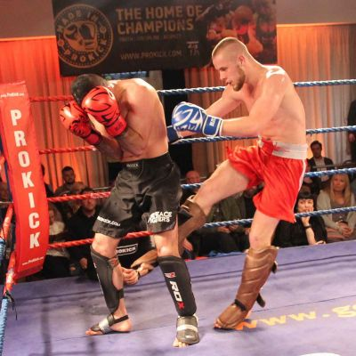 Patryn Klak lands a hard low-kick to ProKick's adopted Iranian Salman Shariati at the Stormont Hotel in Belfast