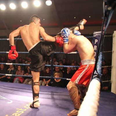 Salman fires a high kick to Polish fighter Patryn Klak  at the Stormont  Hotel Belfast