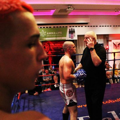 Emery looks on calm and collected as Ref Mr Bob Hunter stops the fight with Shane Weir