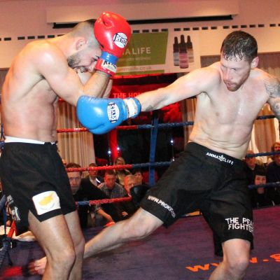 Swift Smith shoots a Low Kick to Christos Venizelou (Cyprus) At the Stormont Hotel Saturday 23rd Feb 2019